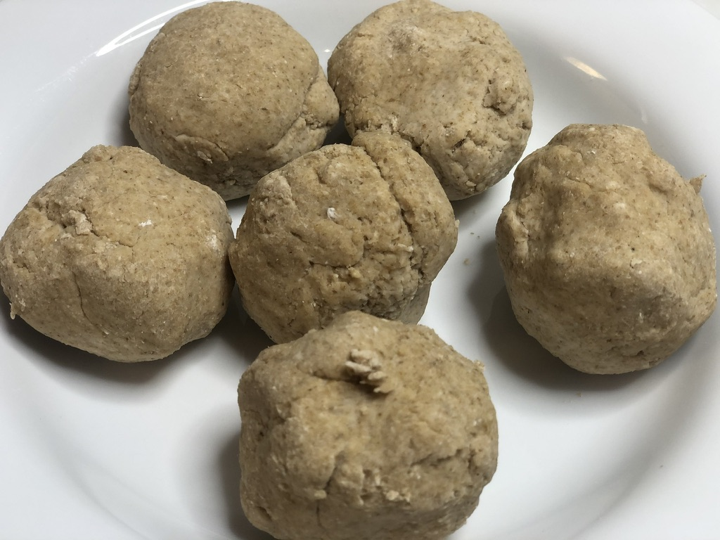 Divide oatmeal tortilla dough into six equal balls