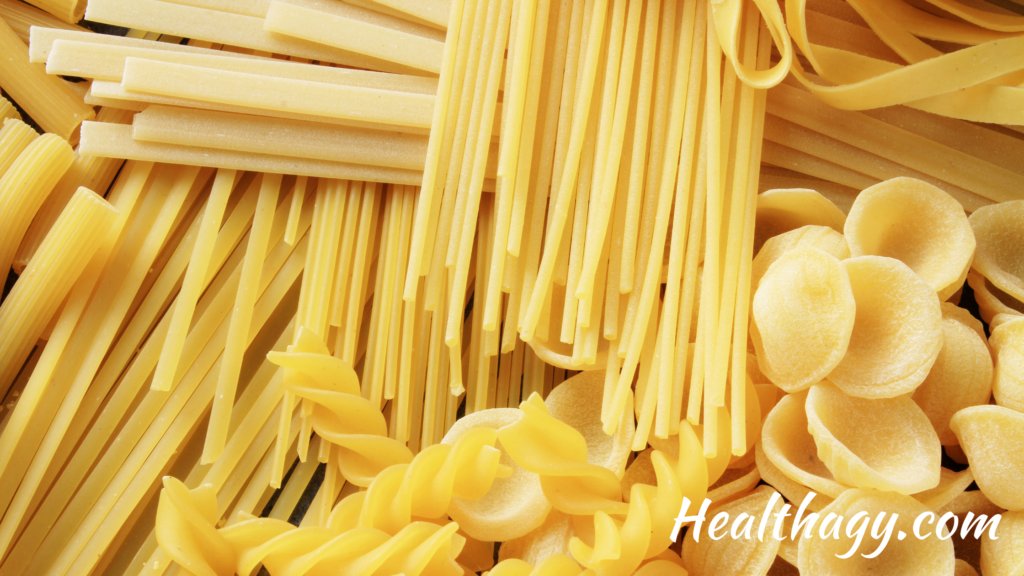 Pasta is a yellow, ivory color.  It comes in long shoe string shapes and spiral shapes. spir