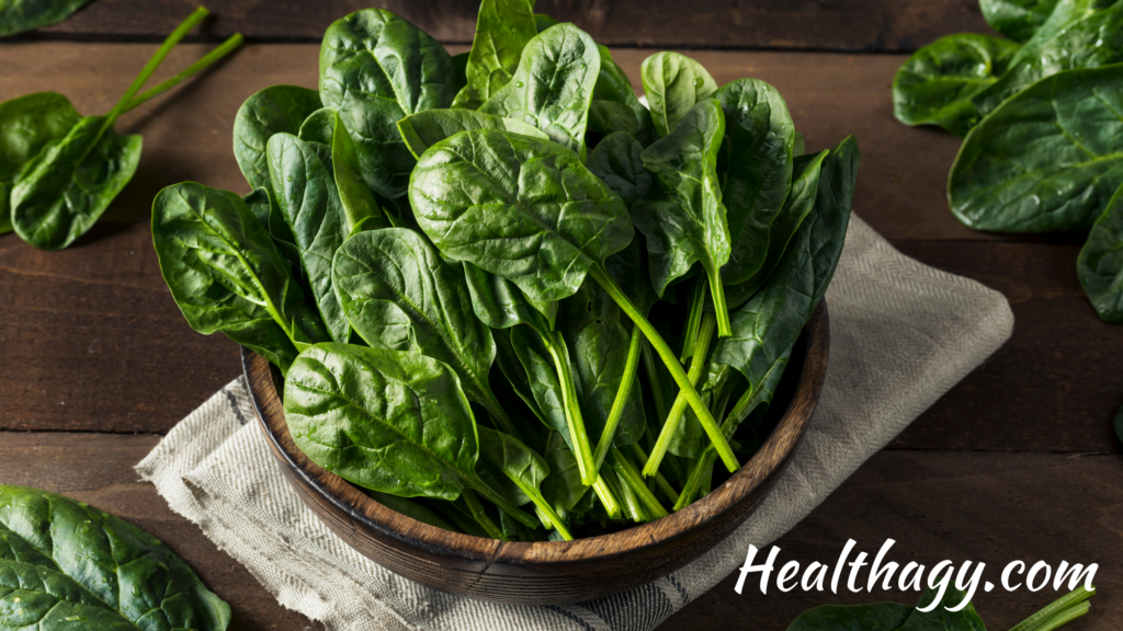 mature spinach leaves are darker green, long and oval shaped with green stems